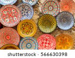colorful dish souvenirs for... | Shutterstock . vector #566630398