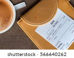 cup of coffee and receipt bill... | Shutterstock . vector #566640262