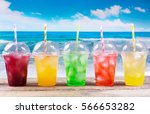 colorful cold drinks in plastic ... | Shutterstock . vector #566653282