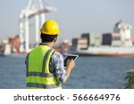 Man Inspect Container In Port
