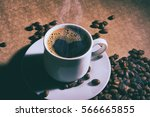 cup of hot coffee with coffee... | Shutterstock . vector #566665855