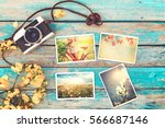 Small photo of Retro camera and instant paper photo album on wood table with flowers border design - photo of remembrance and nostalgia in spring. vintage style