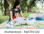 happiness asia mother and baby... | Shutterstock . vector #566701132