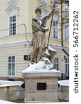 Small photo of LVIV, UKRAINE - January 13, 2017: Statue of Adonis at Market Square in Lviv in winter