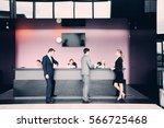 business people at front desk... | Shutterstock . vector #566725468