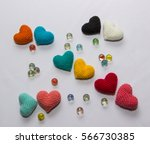 multicolored knitted hearts ... | Shutterstock . vector #566730385