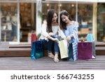 two happy asian shopaholic... | Shutterstock . vector #566743255
