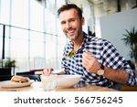 handsome bearded man in checked ... | Shutterstock . vector #566756245