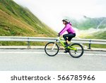 young woman cycling | Shutterstock . vector #566785966