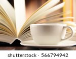 composition with books and cup... | Shutterstock . vector #566794942