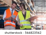 worker and businessmen with... | Shutterstock . vector #566823562