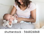 mother with newborn baby in the ... | Shutterstock . vector #566826868
