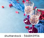 Two Stemmed Champagne Glasses...