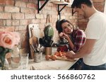 lovely couple in the kitchen | Shutterstock . vector #566860762