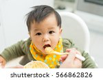 asian baby boy eating blend... | Shutterstock . vector #566862826