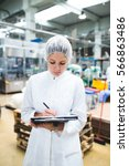 young happy female worker in... | Shutterstock . vector #566863486