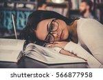 beautiful girl in eyeglasses is ... | Shutterstock . vector #566877958