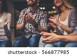 young people are sitting in... | Shutterstock . vector #566877985