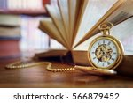 pocket watch and books in... | Shutterstock . vector #566879452