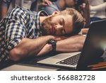 handsome bearded guy is napping ... | Shutterstock . vector #566882728