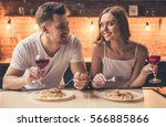 beautiful couple is talking and ... | Shutterstock . vector #566885866