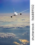 airplane fly over clouds.... | Shutterstock . vector #566889532