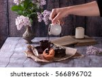 girl pouring chocolate donut.... | Shutterstock . vector #566896702