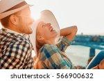 cheerful couple having fun on... | Shutterstock . vector #566900632