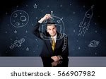 a young happy businessman in... | Shutterstock . vector #566907982