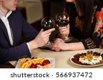 couple toasting wineglasses  | Shutterstock . vector #566937472