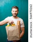 handsome man holding a paper... | Shutterstock . vector #566970262