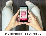 a woman is shopping at the... | Shutterstock . vector #566975572