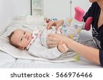 mother changing diapers of a... | Shutterstock . vector #566976466
