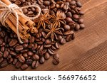 coffee beans and cinnamon on a...   Shutterstock . vector #566976652