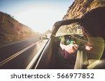 man driving convertible car in... | Shutterstock . vector #566977852