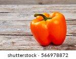 Orange Bell Pepper On Wood....