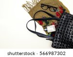 handbag with perfume and scarf | Shutterstock . vector #566987302