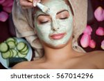 woman receiving spa treatment... | Shutterstock . vector #567014296