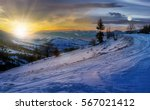day and night time change concept with spruce tree on a rural meadow full of snow in high mountains - stock photo