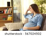 pregnant woman with hand on... | Shutterstock . vector #567024502