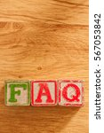 Small photo of Vintage Wooden Children's Blocks spell out the abbreviation FAQ - Frequently Asked Questions