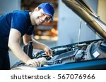 professional car mechanic... | Shutterstock . vector #567076966