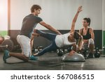 two girl exercising at the gym... | Shutterstock . vector #567086515