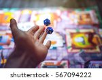 hand throws the dice on the... | Shutterstock . vector #567094222