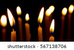 burning candles against black... | Shutterstock . vector #567138706