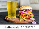 burger and beer. selective focus | Shutterstock . vector #567144292