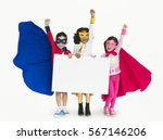Small photo of Superhero Kid Smiling Arms Raised Banner Copy Space