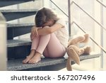 sad little girl sitting on... | Shutterstock . vector #567207496