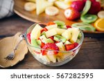 salad with fresh fruits and... | Shutterstock . vector #567282595