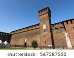 Small photo of Sforza Castle XV century (Castello Sforzesco) in Milan, Lombardy, Italy with Tower of Bona and Giovia and statue of St. Giovanni Nepomuceno, Bohemian priest